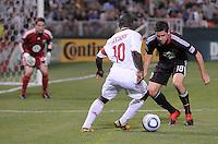 AC Milan midfielder Clarence Seedorf (10) challenges DC United Devon Mctavish (18) DC United defeated AC. Milan 3-2 at RFK Stadium, Wednesday May 26, 2010.