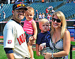 6 September 2009: Cleveland Indians' utilityman Jamey Carroll poses with his wife Kim (right), and twins Mackenzie Joyce and Cole Patrick after a game against the Minnesota Twins at Progressive Field in Cleveland, Ohio. The Indians defeated the Twins 3-1 to take the rubber match of their three-game weekend series. Mandatory Credit: Ed Wolfstein Photo