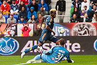 New York Red Bulls goalkeeper Luis Robles (31) denies Gyasi Zardes (29) of the Los Angeles Galaxy on a scoring chance. The New York Red Bulls defeated the Los Angeles Galaxy 1-0 during a Major League Soccer (MLS) match at Red Bull Arena in Harrison, NJ, on May 19, 2013.