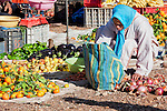 Woman buying vegetables at the Market in Ouarzazate, Morocco.