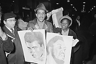 March 8 1971, Manhattan, New York City, New York State, USA --- Boxing Fans Holding Posters Outside Madison Square Garden --- Image by © JP Laffont/Sygma/CORBIS