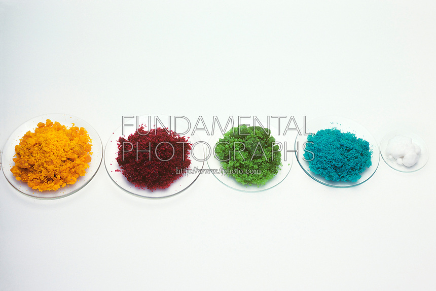 CHLORIDES OF TRANSITION METALS<br /> Crystals of the Chlorides of Transition Metals<br /> From left to right: Iron chloride, cobalt chloride, nickel chloride, cupric chloride, and zinc chloride.