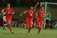 South Korea's Kim Bo Kyung Kim (19) celebrates another goal against the United States during the FIFA Under 20 World Cup Group C match between the United States and South Korea at the Mubarak Stadium on October 02, 2009 in Suez, Egypt. The US team lost 3-0.