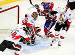 17 October 2009: Ottawa Senators' goaltender Pascal Leclaire makes a first period save against the Montreal Canadiens at the Bell Centre in Montreal, Quebec, Canada. The Senators defeated the Canadiens 3-1. Mandatory Credit: Ed Wolfstein Photo
