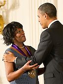 United States President Barack Obama awards the 2011 National Medal of Arts to Rita Dove, an American poet and author, during a ceremony in the East Room of the White House in Washington, D.C. on Monday, February 13, 2012..Credit: Ron Sachs / Pool via CNP