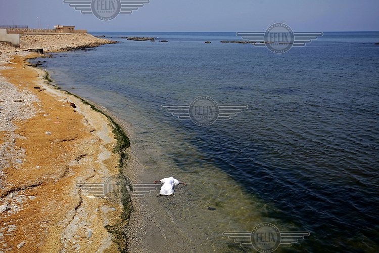 A dead body floats in the Mediterranean Sea.