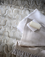 Kasbah, a stone water jet mosaic, shown in honed Angora and Cashmere.