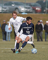 Brandeis forward/midfielder Michael Soboff (20) dribbles as Williams forward Jonathan Westling (11) closes. NCAA Division III Sectionals. Williams College (white) defeated Brandeis University (blue/white), 2-0, on Hitchcock Field at Amherst College on November 23, 2013.