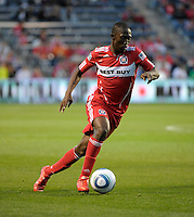 Chicago midfielder Patrick Nyarko (14) dribbles toward the Chivas goal.  The Chicago Fire tied Chivas USA 1-1 at Toyota Park in Bridgeview, IL on May 1, 2010.