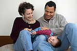 Berkeley Ca Adoptive paretns (Cuban father) delighted with their baby girl, nine-months-old