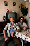 01257_01, France-Political, France, 08/1988, FRANCE-10086NF2. A husband and wife sit at a table.<br />