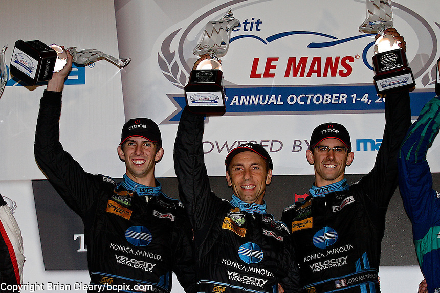Ricky Taylor, Max ANgelelli, Jordan Taylor celebrate, Petit Le Mans , Road Atlanta, Braselton, GA, October 2014.   (Photo by Brian Cleary/www.bcpix.com)