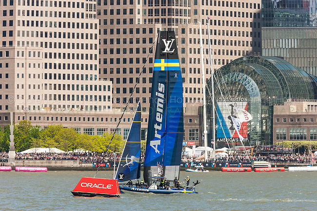 The Artemis Racing Team Sweden catamaran races on the Hudson River near Brookfield Place in the America's Cup World Series.