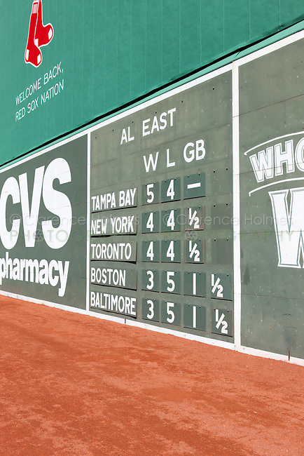 Part of the scoreboard showing current American League East standings on the Green Monster, the famed left field wall in iconic Fenway Park in Boston, Massachusetts.  Fenway is the oldest ballpark in Major League Baseball, dating from 1912.