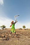 A woman prepares the ground beside her hut for planting in the Habile Camp for internally displaced Chadians outside the village of Koukou Angarana. Some 25,000 people live in precarious conditions in this camp. More than 180,000 residents of eastern Chad have been displaced by violence spilling over from neighboring Darfur, inter-ethnic conflict, and fighting between rebels and the Chadian government.