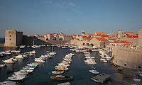 The old harbour of the medieval walled city, Dubrovnik, Croatia, developed by architect Paskoje Milicevic in the 15th century, with the 14th century Fortress of St John or Mulo Tower (left). The city developed as an important port in the 15th and 16th centuries and has had a multicultural history, allied to the Romans, Ostrogoths, Byzantines, Ancona, Hungary and the Ottomans. In 1979 the city was listed as a UNESCO World Heritage Site. Picture by Manuel Cohen