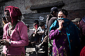 Family members gather to mourn the dead family members outside the Pashupathi Nath Temple in capital Kathmandu, Nepal