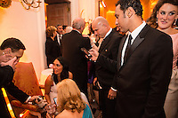 Aasif Mandvi takes a picture of Uggie the dog with his cell phone at the Bloomberg Vanity Fair White House Correspondents' Association dinner afterparty at the residence of the French Ambassador on Saturday, April 28, 2012 in Washington, DC. Brendan Hoffman for the New York Times