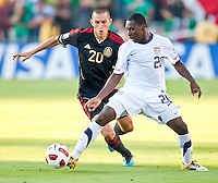 PASADENA, CA – June 25, 2011: Mexican player Jorge Torres Nilo (20) and USA player Freddy Adu (20) during the Gold Cup Final match between USA and Mexico at the Rose Bowl in Pasadena, California. Final score USA 2 and Mexico 4.
