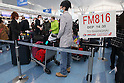 March 17, 2011, Tokyo, Japan - Travelers at Haneda International Airport in Tokyo are anxious to leave Japan. Tokyoites are leaving Tokyo in the aftermath of the Tohoku-Kanto Natural Disaster and due to the ongoing threat of radiation exposure from the Fukushima Daiichi nuclear power plant. (Photo by Yusuke Nakanishi/AFLO)