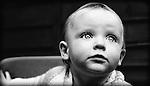A baby looking upwards