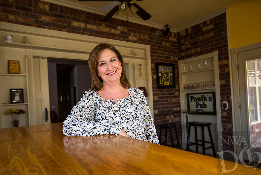 NWA Democrat-Gazette/JASON IVESTER<br /> Becky Paulk; photographed on Monday, Feb. 15, 2016, in her favorite place: the bar area in her Rogers home