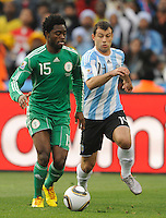 Javier Mascherano of Argentina and Lukman Haruna of Nigeria
