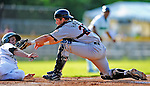 2 July 2011: Tri-City ValleyCats catcher Miles Hamblin gets a sliding Sean Jamieson out at the plate in the first inning of action against the Vermont Lake Monsters at Centennial Field in Burlington, Vermont. The Monsters rallied from a 4-2 deficit to defeat the ValletCats 7-4 in NY Penn League action. Mandatory Credit: Ed Wolfstein Photo