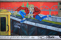 Section of the Berlin Wall depicting the painting Mauerspringer by Gabriel Heimler of a man jumping over the Berlin Wall, damaged by graffiti, part of the East Side Gallery, a 1.3km long section of the Wall on Muhlenstrasse painted in 1990 on its Eastern side by 105 artists from around the world, Berlin, Germany. Picture by Manuel Cohen