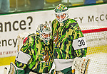 24 November 2013: University of Vermont Catamount Goaltender Mike Santaguida (left), a Freshman from Mississauga, Ontario, gets an embrace from fellow Goaltender Pat Feeley (right), a Freshman from Winthrop, MA, after a game against the University of Massachusetts Minutemen at Gutterson Fieldhouse in Burlington, Vermont. Santaguida made 39 saves to record his first career NCAA shutout as the Cats defeated the Minutemen 2-0 to sweep the 2-game home-and-away weekend Hockey East Series. Mandatory Credit: Ed Wolfstein Photo *** RAW (NEF) Image File Available ***