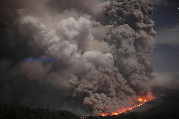 Nighttime view of major dome collapse at Sinabung Volcano causing large sequence of pyroclastic flows, Sumatra, Indonesia