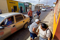 Neighbors greet on the street in Pueblo Nuevo on Venezuela's Paraguaná Peninsula, Dec. 12, 2015. The remote desert peninsula in the Caribbean Sea lays bare the effects of Venezuela's politicized economy after 17 years under Hugo Chavez and successor Nicolas Maduro.