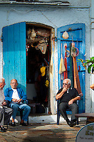 Bastia, Corsica, France, September 2012. Fishermen discuss the catch of the day at their shack in the marina. The town of Bastia is the first city that most people see after arriving on the island by ferry. Corsica is a wildly beautiful French island, scented with myrtle and possessing one of the most diverse landscapes in Europe, from crescent bays with white-sand beaches to montane forests sheltering rugged granite peaks, with miles of untouched coastline, sun-splashed mountain villages. Photo by Frits Meyst/Adventure4ever.com