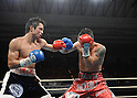 (L-R) Hiroyuki Hisataka (JPN), Hugo Cazares (MEX), DECEMBER 23, 2010 - Boxing : Hiroyuki Hisataka of Japan and Hugo Fidel Cazares of Mexico in action during the 9th round of the WBA super flyweight title bout at Osaka Prefectural Gymnasium in Osaka, Osaka, Japan. (Photo by Mikio Nakai/AFLO).