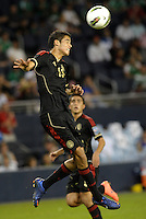 Diego Reyes (13) Mexico clears the ball... Mexico defeated Canada 3-1 in Olympic Qualifying semi final at LIVESTRONG Sporting Park, Kansas City, Kansas.
