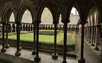 40 metres above the rock, the Cloister with its double row of frail looking arches on the garden side, the slender columns, set in a quincunx pattern linked at the top by diagonal arches form a series of stable tripods supporting the roof; the spandrels between the moulded arches  are decorated throughout with carved rosettes and foliage. the Merveille (Marvel), 13th century, thanks to a donation by the king of France, Philip Augustus who offered Abbot Jourdain, a grant for the construction of a new Gothic-style architectural set, Le Mont Saint Michel, Manche, Basse Normandie, France. Picture by Manuel Cohen