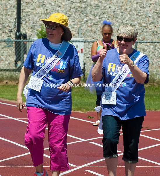 WINSTED, CT--061315JS02-   April Feathers, right, of Branford, give two-thumbs up as she and her friend Jacolyn Brown of East Cannan, left, take the Survivor Lap during the annual Relay For Life walk for Northwester Regional 7 High School in Winsted. Feathers is a 17-year cancer survivor and Brown in in her first year as a survivor. The events geld throughout the state,  is a fundraiser that benefits the American Cancer Society.<br /> Jim Shannon Republican-American