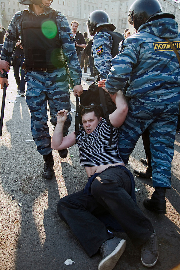 Moscow, Russia, 06/05/2012..Police arrest protestors at opposition demonstration against Russian Presidential election results on the eve of Vladimir Putins inauguration as President.
