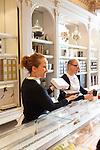 Saleswomen engage with customers at Angelina, Rivoli Street, Rue de Rivoli, Paris, France, Europe
