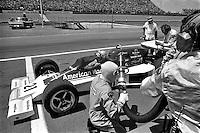 BROOKLYN, MI - SEPTEMBER 18: Al Unser makes a pit stop in his Parnelli VPJ6B 001/Cosworth TC during the Michigan Grand Prix IndyCar race at Michigan International Speedway near Brooklyn, Michigan, on September 18, 1976.
