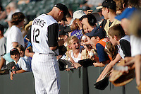 Colorado Rockies shortstop Clint Barmes signs autographs for young fans prior to a game against the San Francisco Giants. The Giants defeated the Rockies 6-5 at Coors Field in Denver, Colorado on May 20, 2008. FOR EDITORIAL USE ONLY. FOR EDITORIAL USE ONLY