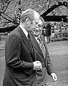 United States President Gerald R. Ford, left, and Secretary of State Henry Kissinger, right,  walk through the Rose Garden at the White House in Washington, D.C. on April 29, 1975.  They escorted King Hussein of Jordan back to his limousine after meeting on the situation in the Middle East.<br /> Credit: Arnie Sachs / CNP