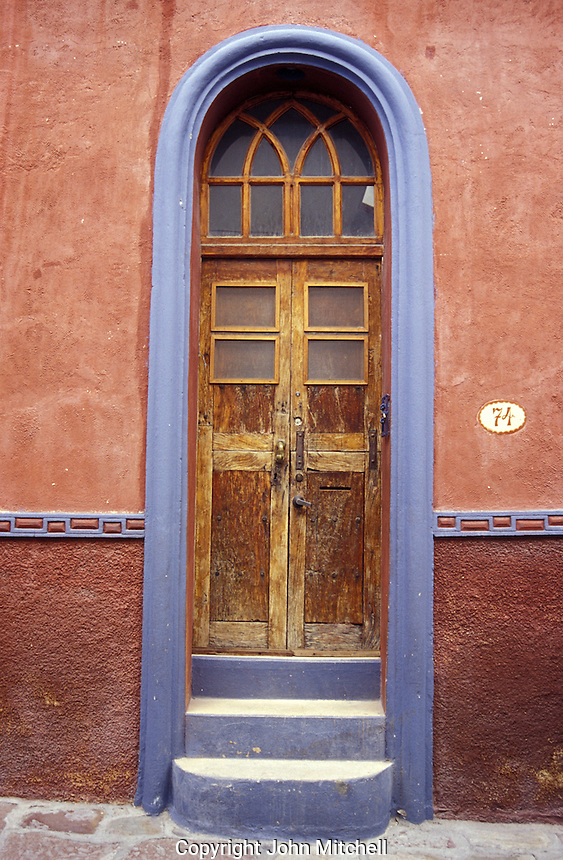 Old door of a restored Spanish colonial house in San Miguel de Allende, Mexico