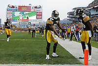 PITTSBURGH, PA - OCTOBER 30:  Antonio Brown #84 of the Pittsburgh Steelers celebrates in front of teammate Emmanuel Sanders #88 after scoring a touchdown against the New England Patriots during the game on October 30, 2011 at Heinz Field in Pittsburgh, Pennsylvania.  (Photo by Jared Wickerham/Getty Images)