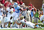 01 September 2012: UNC's Giovanni Bernard (26) is knocked out of bounds by Elon's Kenton Beal (84). The University of North Carolina Tar Heels played the Elon University Phoenix at Kenan Memorial Stadium in Chapel Hill, North Carolina in a 2012 NCAA Division I Football game.