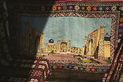 A carpet for sale depicting the once important Islamic studies teaching schools, now a tourist destination, in Registan Square, Samarkand, one of the fabled Central Asian cities of the old Silk Road trading route. Uzbekistan.