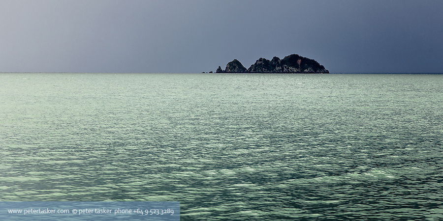 Tarahiki Island, as seen from Opopo Bay, Waiheke Island.  Unusual weather and light.