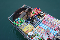 , Vietnam - 2007 File Photo -<br /> little boy in a small boat full of merchandise in<br /> Ha Long Bay<br /> <br /> <br /> <br /> photo : James Wong-  Images Distribution