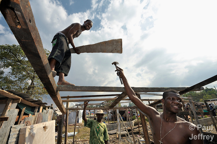 Men in Leogane, Haiti, work building a temporary shelter for their families, which were left homeless by a January 12 earthquake.