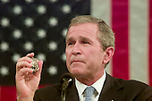 Washington, DC - September 20, 2001 -- U.S. President George W. Bush holds the Police Badge of George Howard, who died at the World Trade Center trying to save others as he spoke before a Joint Session of Congress at the Capitol in Washington, D.C. on September 20, 2001 to detail his plan to combat terrorism.  Howard's badge was given to the President by his mother, Arlene..Credit: Win McNamee - Pool via CNP